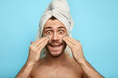 Funny crazy man with mask on his cheek having fun royalty free stock image