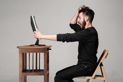 Funny and crazy man using a computer Royalty Free Stock Photos