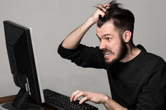 Funny and crazy man using a computer Royalty Free Stock Images