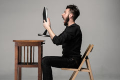 Funny and crazy man using a computer Royalty Free Stock Image