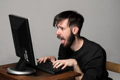 Funny and crazy man using a computer Stock Photo