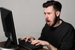 Funny and crazy man using a computer Stock Photos