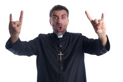 Funny crazy priest rock symbol with fingers royalty free stock photo