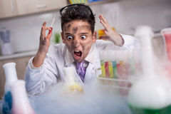 ,funny crazy scientist boy working in a laboratory Royalty Free Stock Image