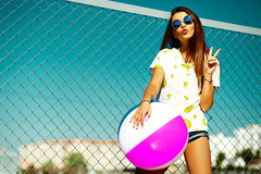 Funny crazy stylish model girl in the street in casual hipster summer cloth Stock Images