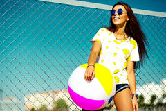 Funny crazy stylish model girl in the street in casual hipster summer cloth Royalty Free Stock Images