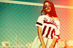 Funny crazy stylish model girl in the street in casual hipster summer cloth Royalty Free Stock Image