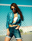 Funny crazy stylish model girl in the street in casual hipster summer cloth Royalty Free Stock Photo