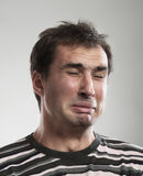 Funny crying man Stock Photography