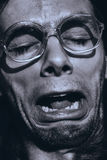 Funny crying man in glasses. Close up funny crying man in glasses Royalty Free Stock Images