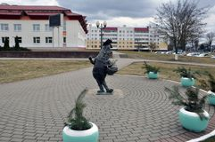 Funny cucumber standing on legs, holding a basket and flower. Shklovsky district Belarus. royalty free stock image