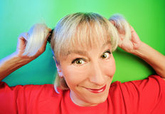 Funny cunning woman portrait. On vivid color background stock photos