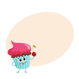 Funny cupcake character with pink cream topping Stock Photography