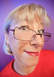 Funny curious woman portrait. On vivid color background royalty free stock image