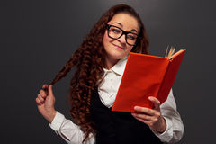 Funny curly woman reading a novel Stock Images
