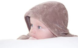 Funny cute baby boy in a hood Stock Photos