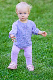 Funny cute baby girl on grass Stock Image