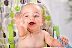 Funny cute baby holding spoon Royalty Free Stock Images