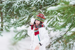 Funny cute boy snow ball in snowy winter park Stock Photography