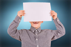 Funny cute boy with white sheet of paper Stock Images