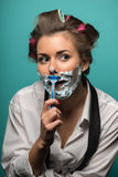 Funny cute brunette in hair curlers posing with Royalty Free Stock Photo