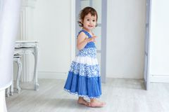 Little girl in bright room stock photos