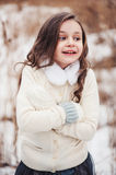 Funny cute child girl in winter forest Royalty Free Stock Photography