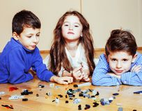 Funny cute children playing toys at home, boys and girl smiling, Stock Image