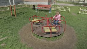 Funny cute girl is playing. Joyous female child having fun on playground stock video