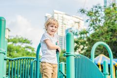 Funny cute happy baby playing on the playground. The emotion of happiness, fun, joy royalty free stock photo