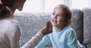 Funny cute kid girl preschooler learning pronunciation with speech therapist