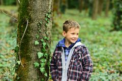 Funny and cute. Funny kid. Small kid play in woods. Small boy have fun outdoor. Being funny I can make girls smile.  royalty free stock photo