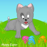 Funny and cute kitten found Easter eggs. Holiday background, greeting card, poster or placard template in cartoon style. Funny and cute kitten found Easter eggs Stock Photo