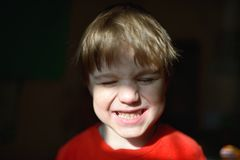 Funny cute little boy in sunbeam Royalty Free Stock Photos