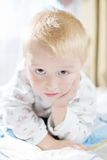 Funny cute little child in pyjamas with blonde hair Stock Photo