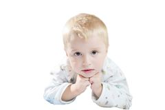 Funny cute little child in pyjamas with blonde hair isolated Royalty Free Stock Images
