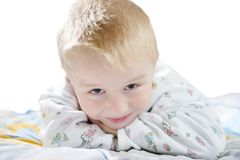 Funny cute little child in pyjamas with blonde hair isolated Royalty Free Stock Photo