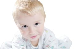 Funny cute little child in pyjamas with blonde hair isolated Stock Images