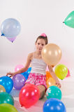 Funny cute little girl with baloons Stock Images