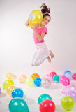 Funny cute little girl with baloons Stock Photos