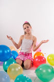Funny cute little girl with baloons. Cute little girl with baloons stock photo