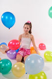 Funny cute little girl with baloons Stock Image