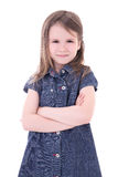 Funny cute little girl in denim dress with crossed hands isolate Royalty Free Stock Image