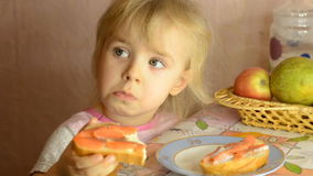 Funny Cute Little Girl Eat Salmon Fish stock footage