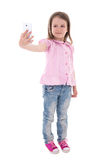 Funny cute little girl taking selfie photo with smart phone isol Royalty Free Stock Photos