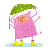 Funny Cute Monster under Rain Royalty Free Stock Photography