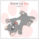 Funny and cute playing kitten for World Cat Day. Holiday background, greeting card, poster or placard template in Royalty Free Stock Image