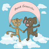 Funny and cute puppy and kitten friends jumping on clouds Royalty Free Stock Photography