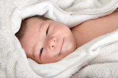 Funny and Cute Smiling Baby Looking at Camera Stock Photography