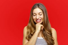 Funny cute smiling woman. Beautiful laughing girl over red background royalty free stock photos